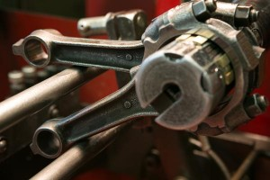 closeup-piston-rods-in-rod-reconditioning-machine