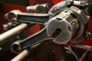 closeup-piston-rods-in-rod-reconditioning-machine