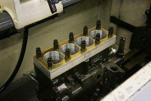 close-up-engine-block-in-sunnen-hone-machine